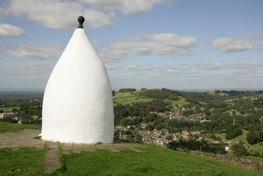 Town of Bollington, England. The Grade II Listed White Nancy folly located on the ridge of the Saddle of Kerridge overlooking the town of Bollington in East Cheshire. White Nancy was built in the early 19th century by John Gaskell to commemorate the Victory at the battle of Waterloo.