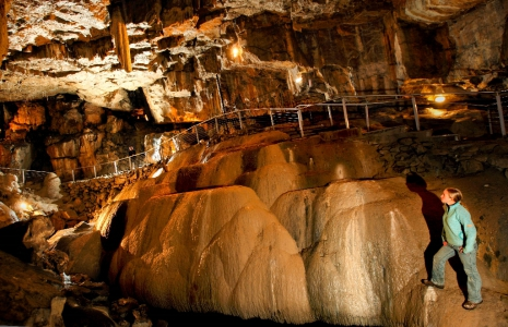 Poole's Cavern or Poole's Hole is a two-million-year-old natural limestone cave on the edge of Buxton in the Peak District